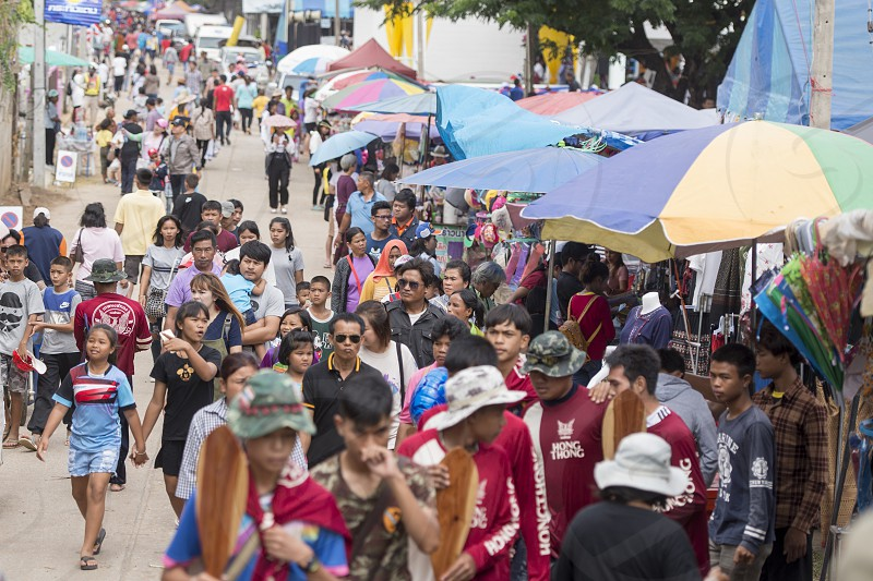 the market street at the traditional Longboat Race at the Khlong Chakarai River in the Town of Phimai in the Provinz Nakhon Ratchasima in Isan in Thailand.  Thailand Phimai November 2017 photo