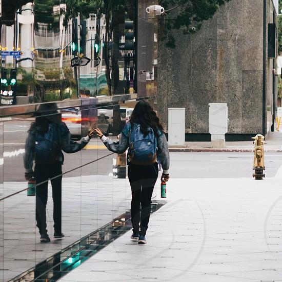 woman in blue backpack walking photo