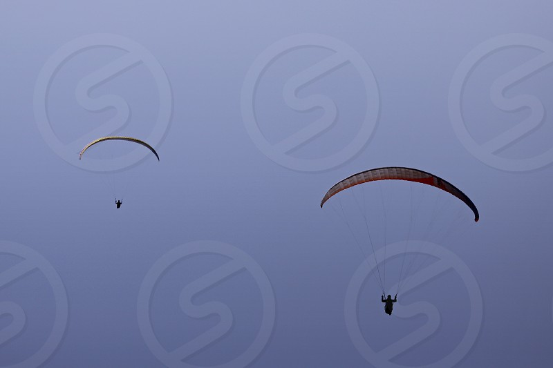 person in parachute in mid air photo