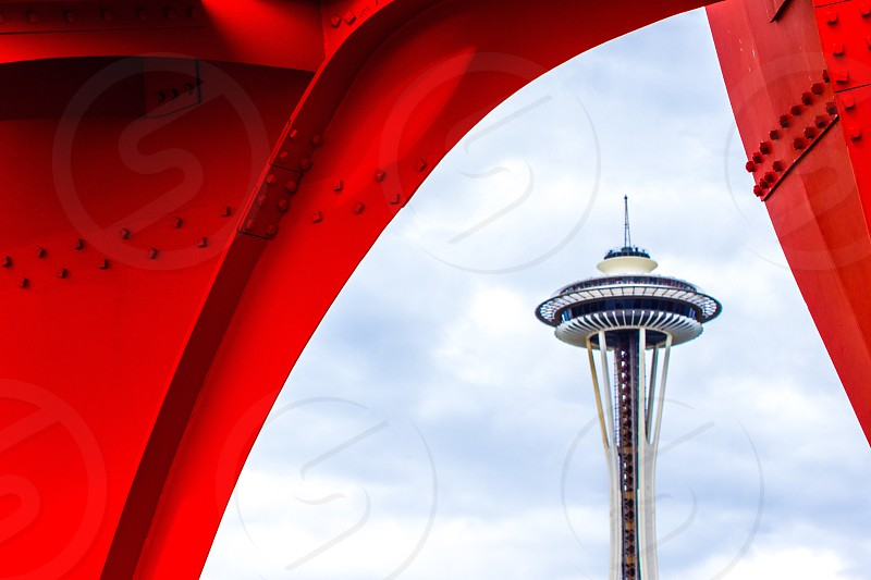 space needle of seattle washington seen from red metal beam photo
