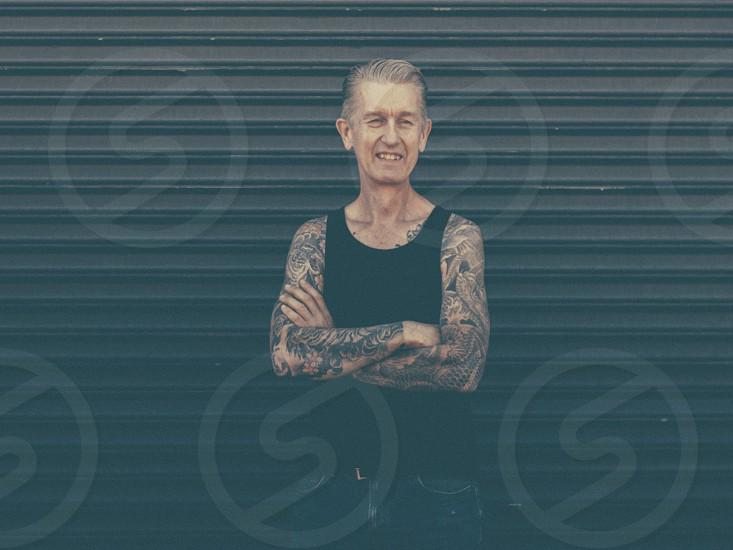 man in black tanktop with body tattoo photo
