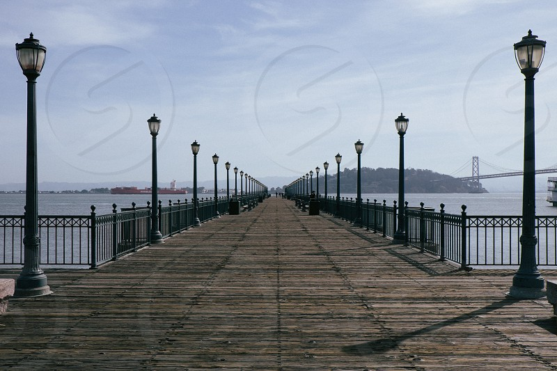 Pier 7 in San Francisco with the Oakland Bay Bridge in the distance. Symmetry and texture galore.  photo