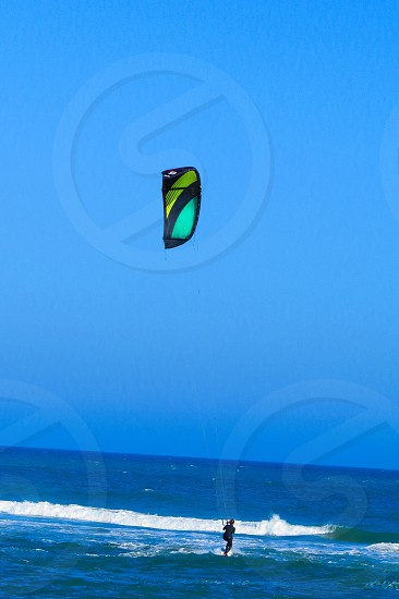 Kiteboarding kite Surfing ocean waves athlete waves  photo