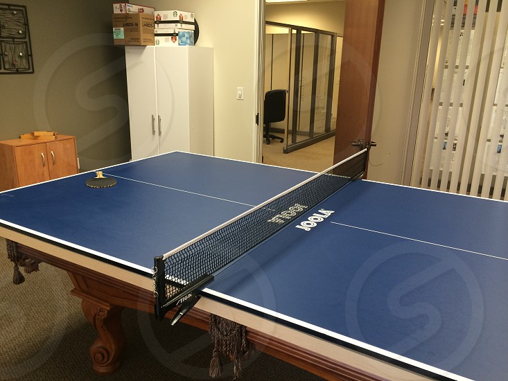 brown wooden ping pong table photo