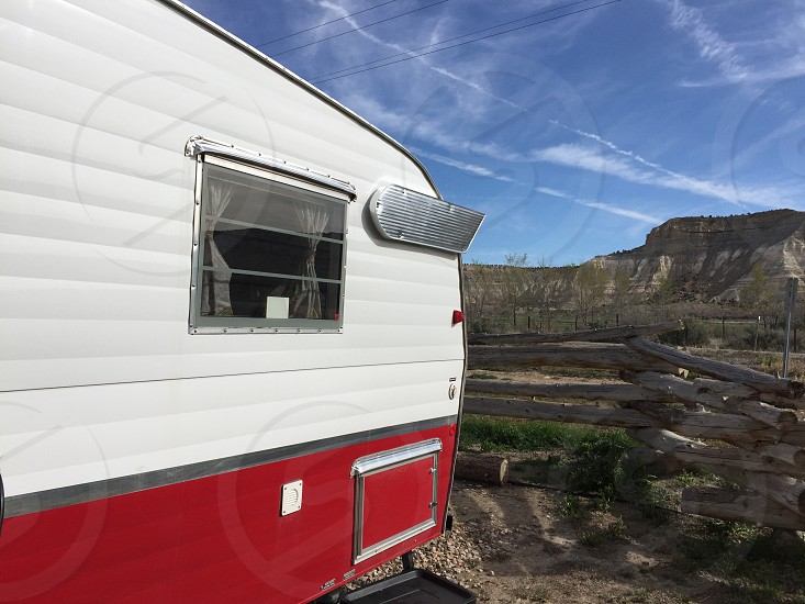Airstream trailer camping travel Utah Route 66 Americana retro road trip glamping red and white motor home trailer in the canyons of Utah Bryce Canyon Zion photo