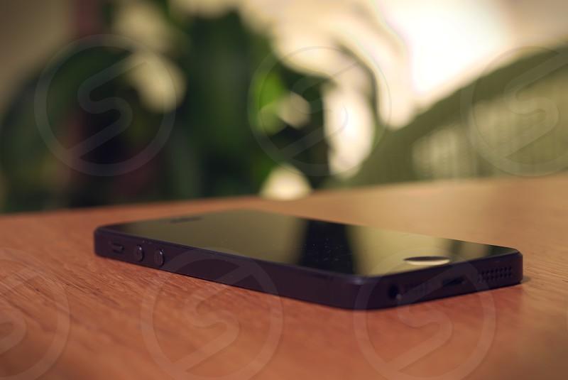 black smartphone on wood photo