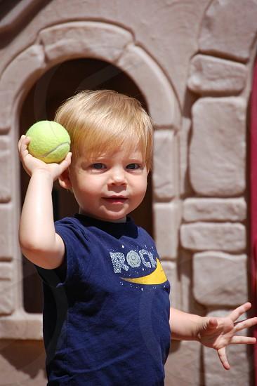 Toddler throwing ball photo