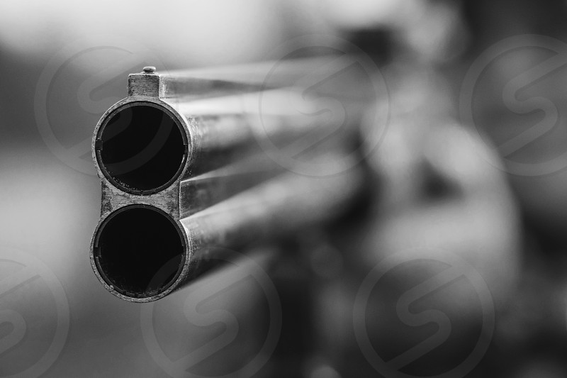 Close up of double barrel hunting gun. Black and white photo