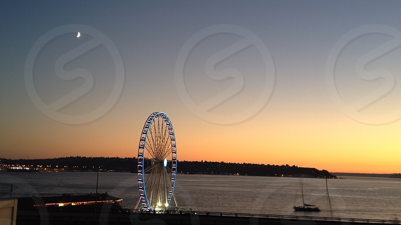 Farris wheel on peir shot at dusk photo