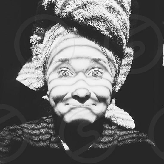 brown bathroom towel on woman's head photo