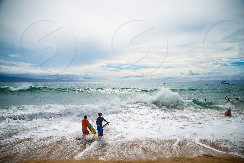 young boys enjoying the Pacific waves  photo