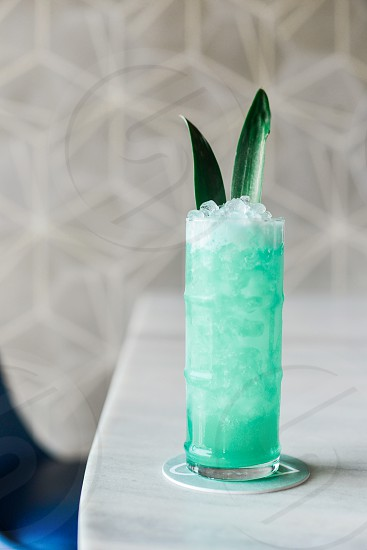 drink with crushed ice and green leaf photo