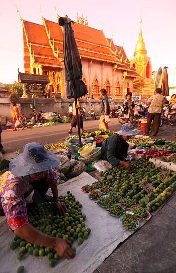 the marketstreets in front of the Wat Mung Muang  in the morning in the city centre of Chiang Rai in the north provinz of chiang Rai in the north of Thailand in Southeastasia. photo