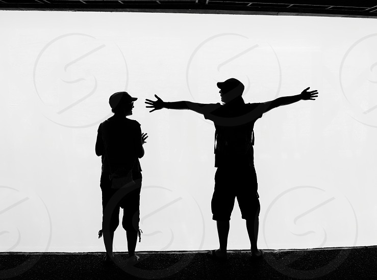 two men silhouette photo