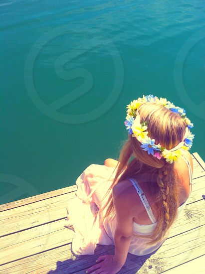 girl on pier with flower headband photo