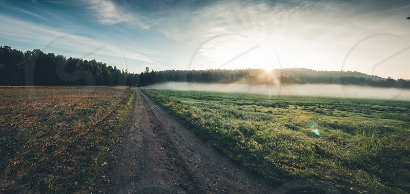 A countryside road early in the morning.  photo