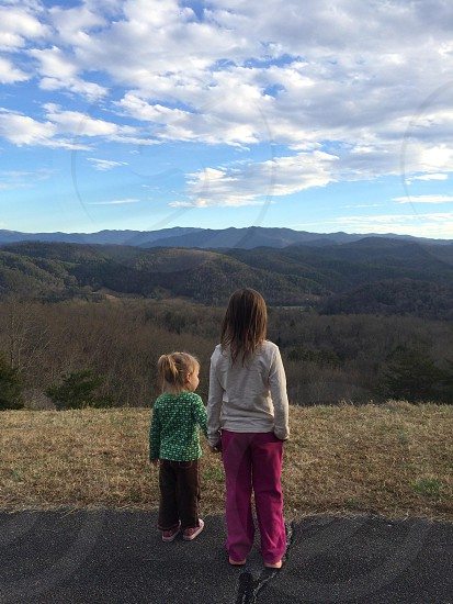 My munchkins looking out over the Great Smoky Mountains from the Foothills Parkway in Blount County Tennessee photo