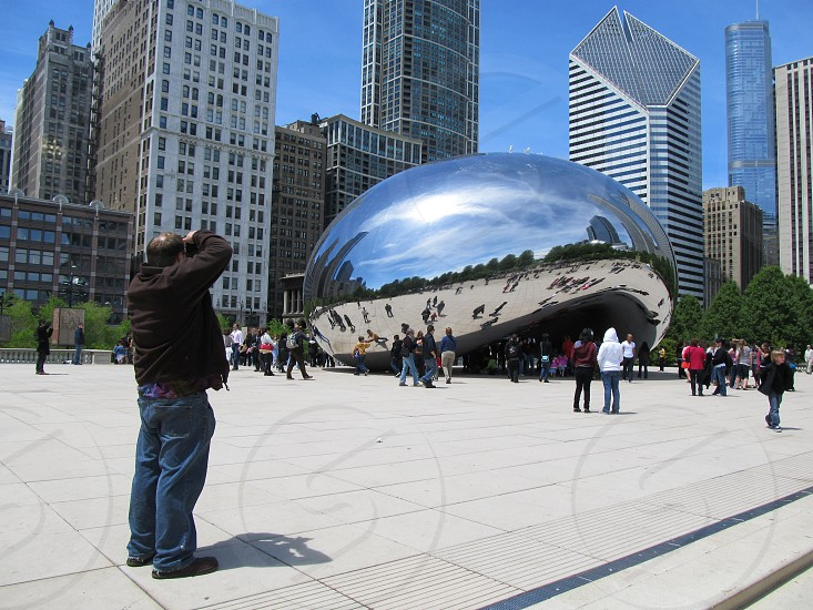 Photographer shooting a public artwork photo