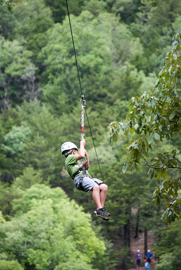 Never too young or too old to seize the day fly thru the forest on a zipline in Lake of the Ozarks Missouri photo