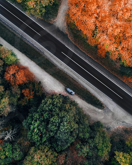 Aerial landscape of a car parked by the road in autumn photo