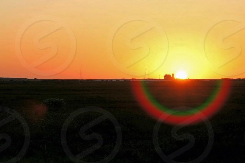 Sunset over Chatham Cape Cod MA. Sunset yellow orange bright silhouette horizon landscape  photo