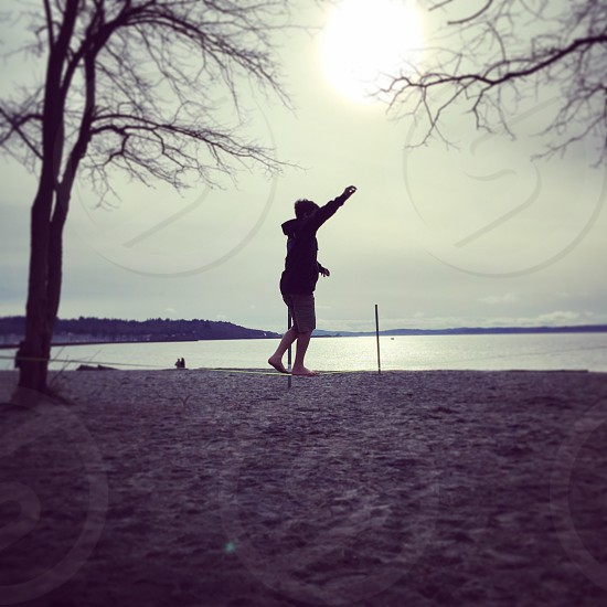 slackline beach silhouette boy  photo