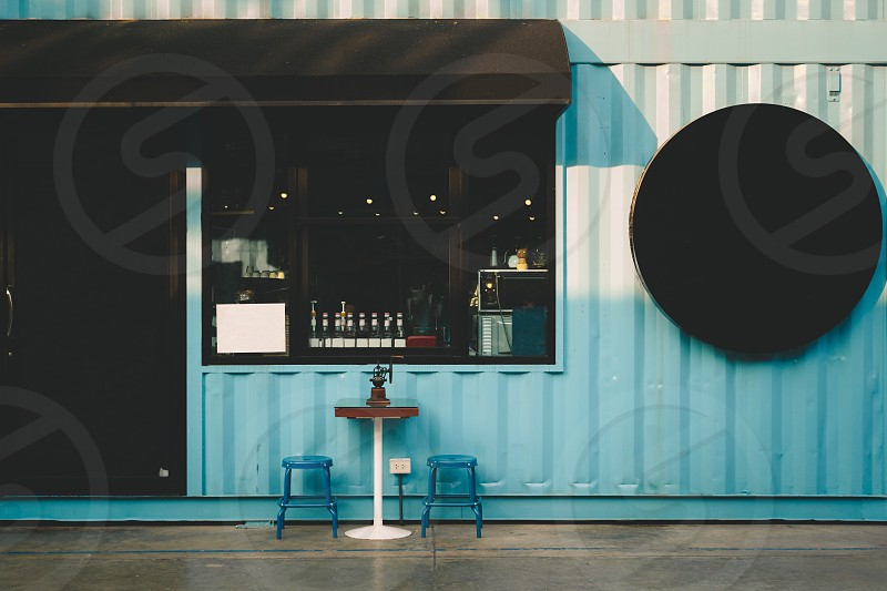 outdoor cafe street table awning town white coffee european drink break restaurant light summer chocolate old people black door traditional love front window wall lifestyle retro design architecture color blue relax cake poster art store wooden vintage background food shop vacation exterior photo