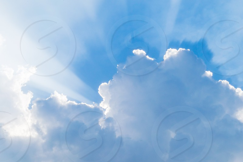 blue sky with rays after raining. Rays appearing with cloud burst photo