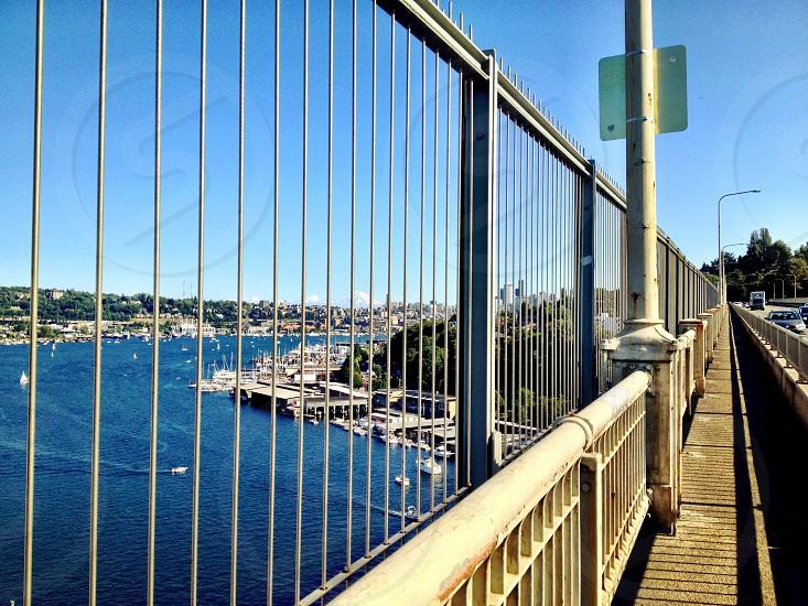 silver metal railing of bridgeway photo