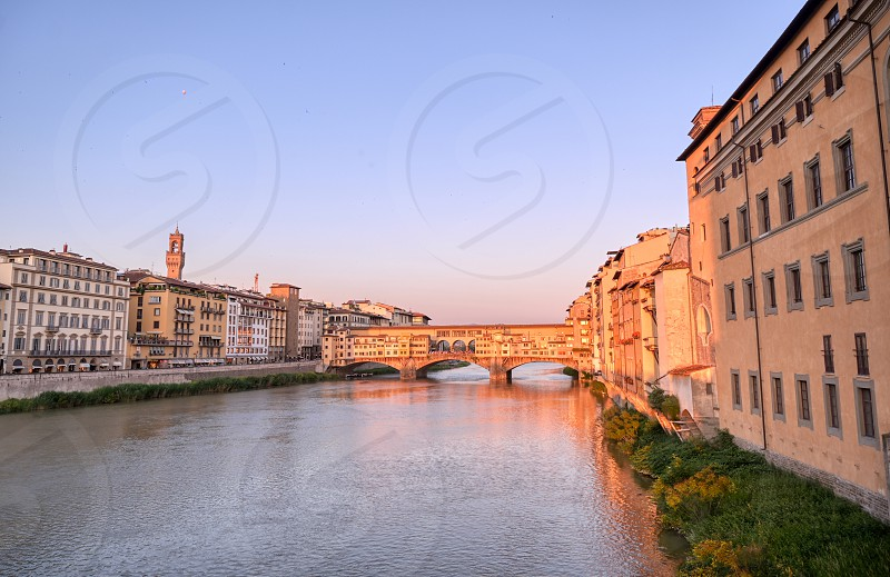 A view of the Arno River and the Ponte Vecchio in Florence Italy. photo