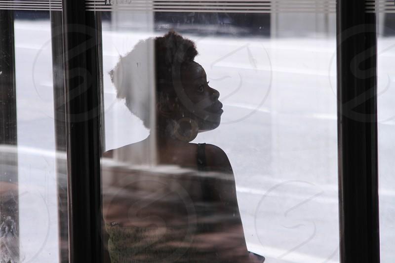 Black woman at bus stop photo