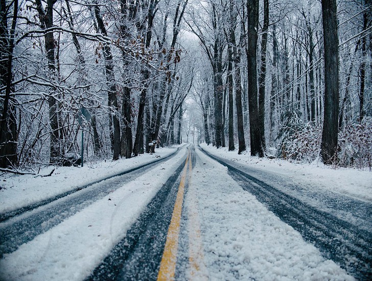 grey concrete road covered by snow photo