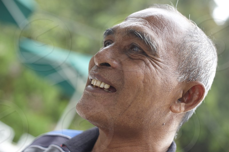 Close up portrait of a friendly Indian man happily smiling photo
