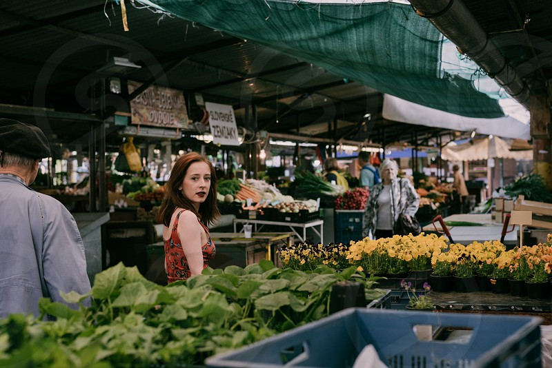 Young woman and old-school vibes of a city outdoor market. photo