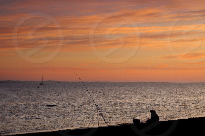 Fishing At Sunset photo