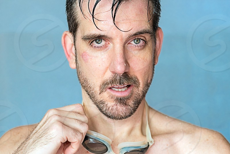 Self Portrait wet male swimming after surviving malignant melanoma surgeries on face with skin graft scar.  photo