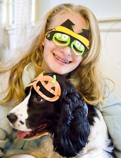 woman with eye mask near dog photo