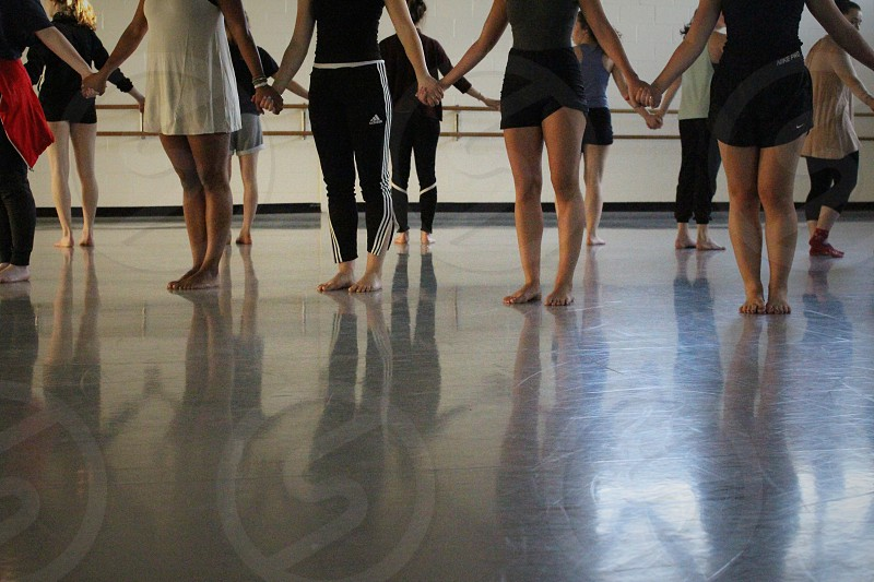 Dancers shadows studio legs arms strong light feet holding hands photo