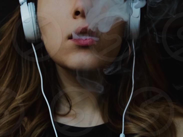 Portrait girl smoking smoke  photo