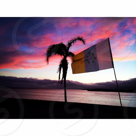 white blue and yellow striped flag with star photo