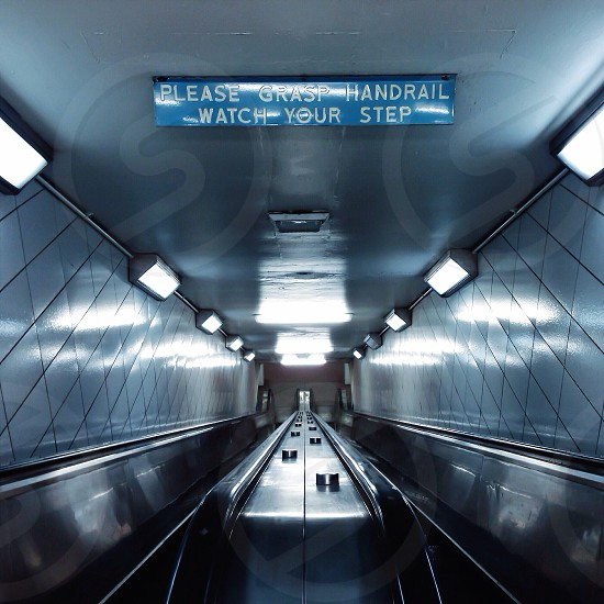 stainless steel escalator in front photo