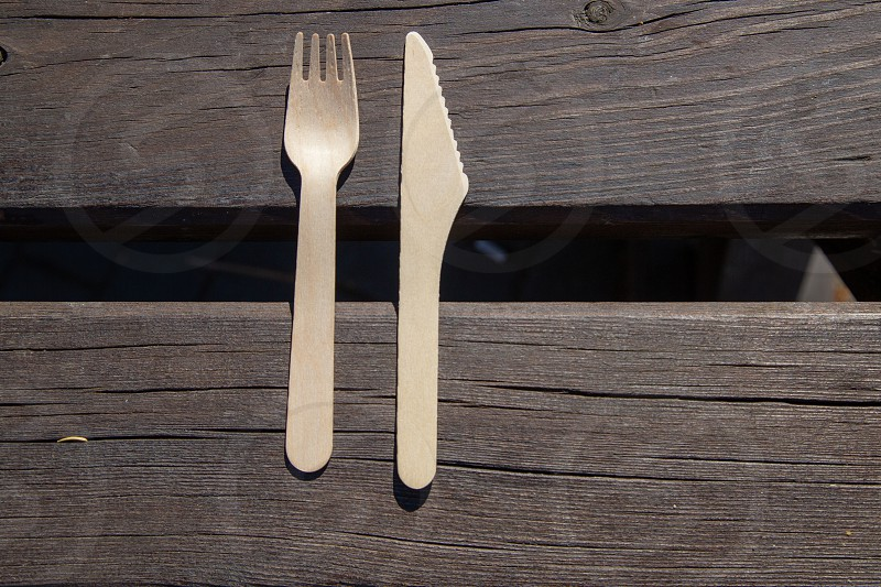 wooden cutlery on a table photo