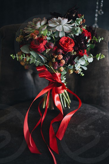 beautiful bouquet of exotic flowers in dark red tones succulent BlackBerry peonies roses photo
