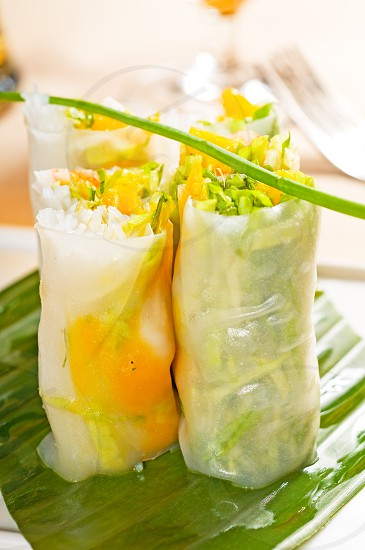 fresh tipycal vietnamese style summer rollson a palm leaf photo