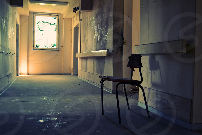 Chair hallway abandoned elderly home Buch Germany photo