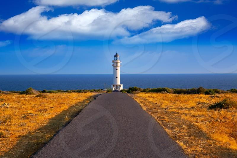 Barbaria cape Lighthouse in Formentera Mediterranean Balearic islands of Spain photo