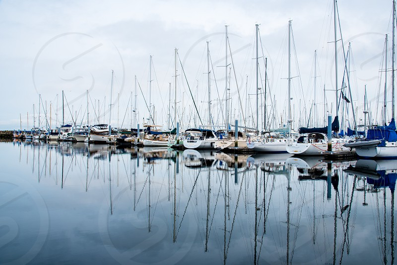 Harbor boats water reflection clouds washington Marina mast sail boat dock photo