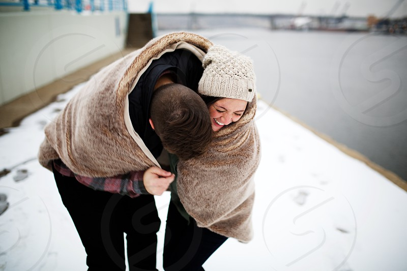 Winters in Minnesota are something to laugh about. Engagement Session Winter photo