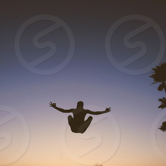 person jumping silhouette photo photo