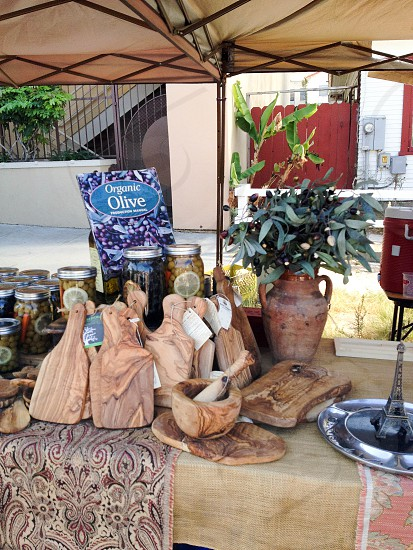 Olives and olive wood for sale at San Diego Farmer's Market farm to table organic artisan homemade photo